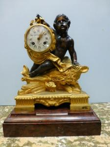 GILT AND BROWN BRONZE CLOCK. JULIEN LEROY. 19th CENT.