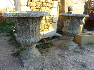PAIR OF RECONSTITUED STONE MEDICIS STYLE URNS.