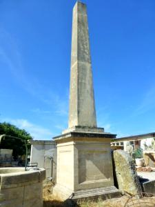 TALL STONE MADE OBELISK.
