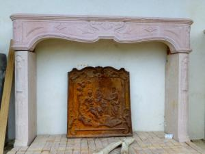 CARVED STONE FIREPLACE.